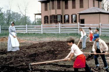 Children were expected to help the farm wife tend the garden.