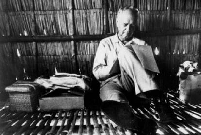 Charles A. Lindbergh writing in a Taboli hut in the Philippines
