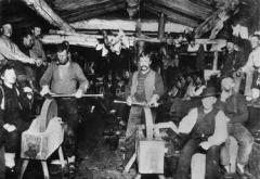 Interior of a logging camp sleepcamp, or bunkhouse, 1890.