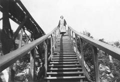 Woman Standing on Stairway Down to Lake Split Rock Lighthouse (1925)